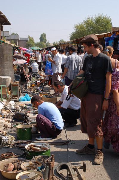 Yann admires items on display at the Yangiobod Weekend Flea Market