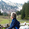 Ausflug to an Alm - notice the lack of flowers, replaced by snow...<br /> <br /> Though I love this series of Brigitte - in deep contemplation of the mountains...