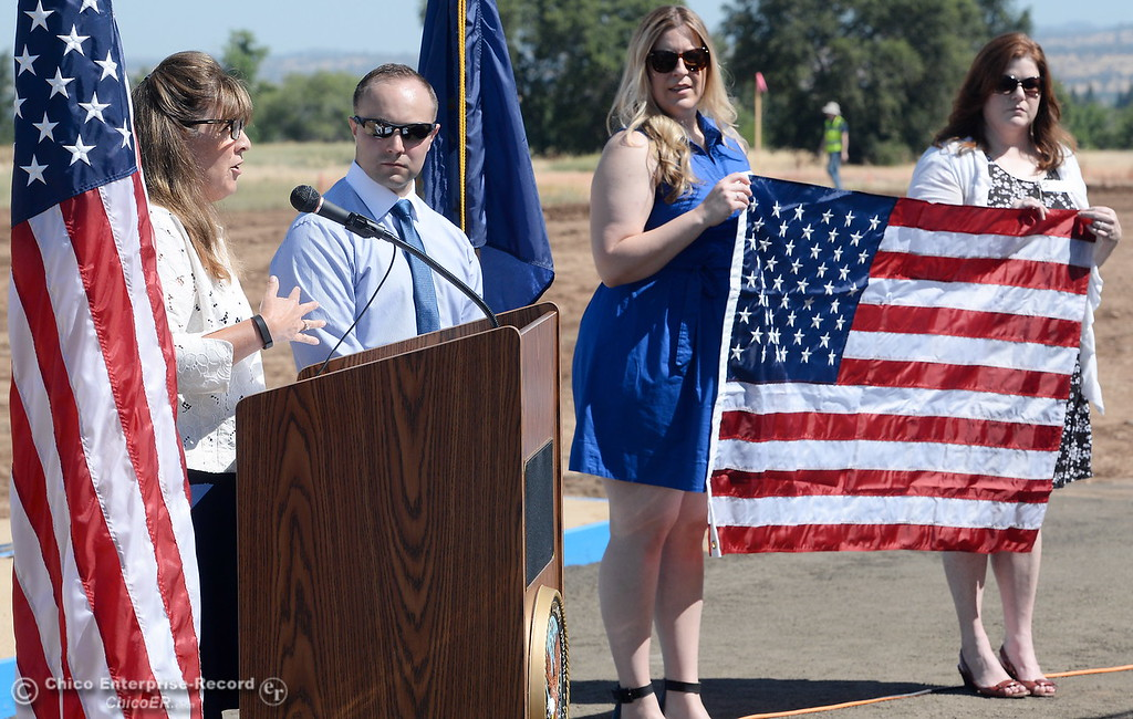 . Laura Page, District Representative for Congressman Doug LaMalfa presents a flag that was flown over the nations capital on April 2 of this year at the request of LaMalfa to the group during a groundbreaking ceremony for the Chico VA Outpatient Clinic at 2000 Concord Ave. in Chico, Calif. Thursday June 29, 2017.  (Bill Husa -- Enterprise-Record)