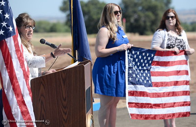 Laura Page, District Representative for Congressman Doug LaMalfa presents a flag that was flown over the nations capital on April 2 of this year at the request of LaMalfa to the group during a groundbreaking ceremony for the Chico VA Outpatient Clinic at 2000 Concord Ave. in Chico, Calif. Thursday June 29, 2017.  (Bill Husa -- Enterprise-Record)