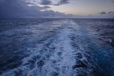 Standing at the rear of the ship, watching the churning water.  A good place to go hide and be quiet...