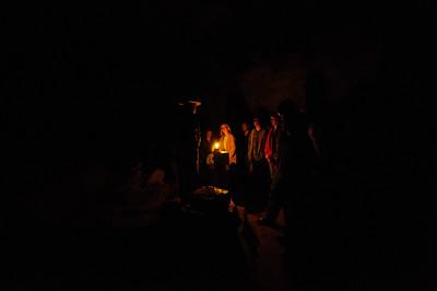 Park ranger chat by lantern light