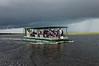 party boat hurrying back, Chobe river cruise, Botswana