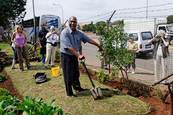 Steven with a click and his new tree, Soweto, S. Africa