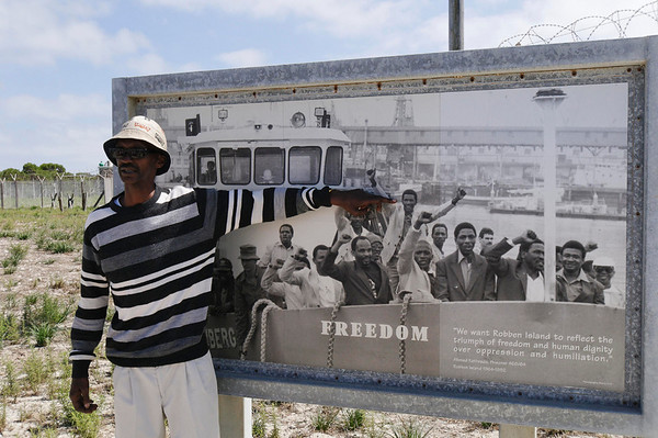 Mathe, ex-prisoner, pointing to himself, Robben Island, South Africa