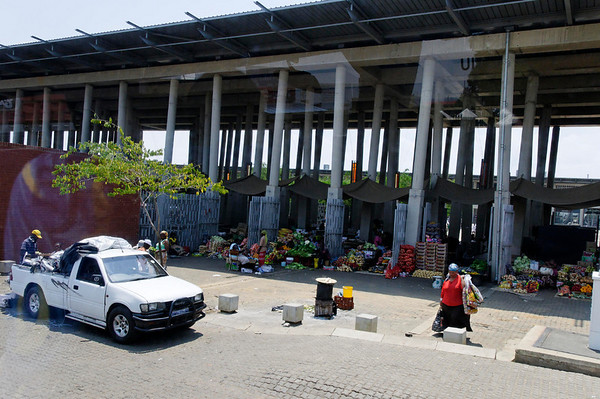 vendors under overpass, Soweto, S. Africa