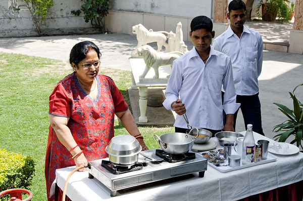 Mom gives the cooking demonstration