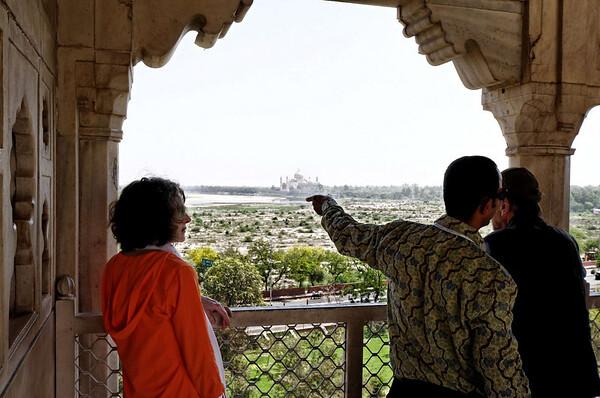 Girish pointing out the Taj Mahal, Agra Fort