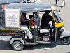 Well dressed child in three-wheeler, Jhansi