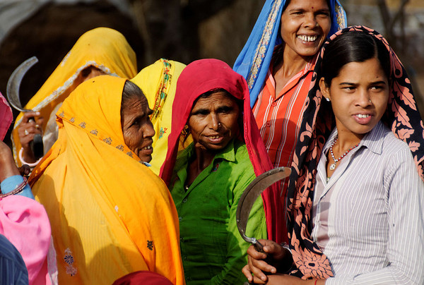 Women getting ready to go to the fields, on the road to Agra