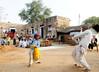 Boy and elder doing a dance, Kalakho