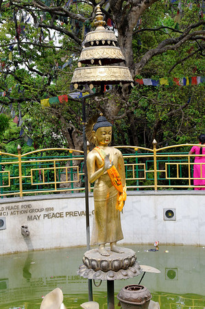 World Peace Pond, pot for throwing coins, Swayambhunath Temple (250 BC) and Buddhist complex, Kathmandu