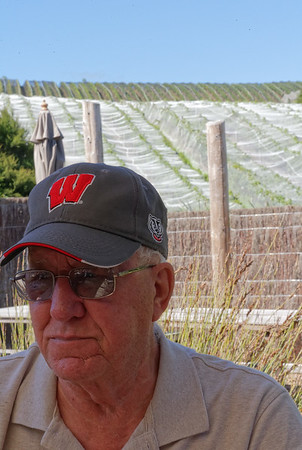 Dennis and the covered grape vines