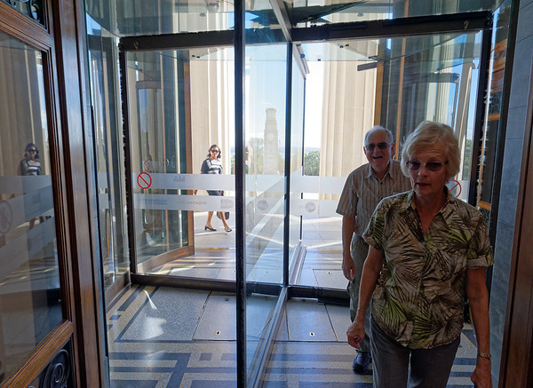 Larry and Madeline go through the revolving doors that rotate clockwise in this hemisphere
