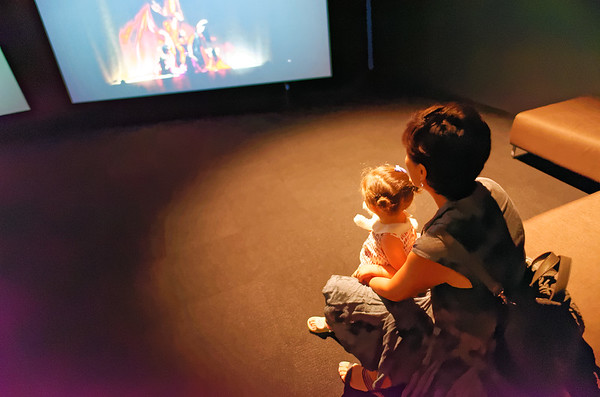 Mother and child watching the movie