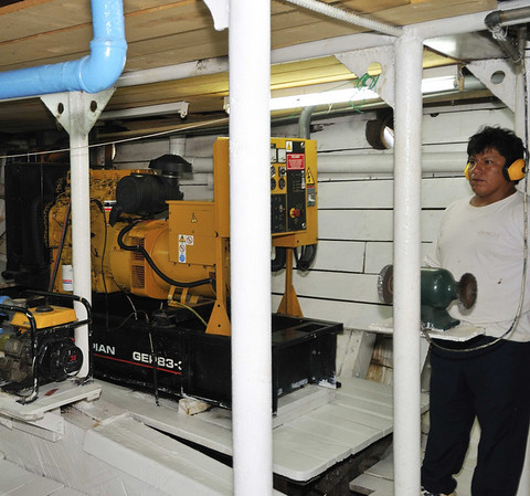 The noise is deafening in Engineer Roberto Matos work area, La Amatista engine room tour, Gallito, The Amazon River, Peru
