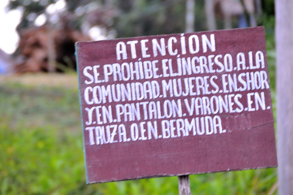 Sign prohibiting women entering the village wearing shorts, mens pants, trousers, or bermuda shorts, La Reforma, Rio Tapiche, Peru