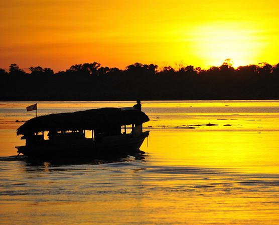 Local water taxi & sunset, Canal de Puinahua, Peru