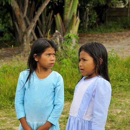 Girls greeting us at Nueva Reforma, a Catholic sect named Los Cruzistas - women in skirts and the boys in pants, La Reforma, Rio Tapiche, Peru