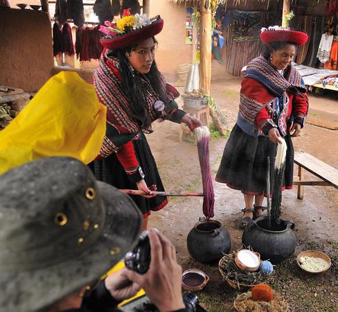 Dipping handspun yarn in natural vegetable dyes, Willoq Community, Peru