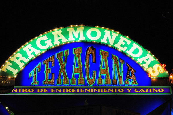 Texacana in Peru, tragamonnedas translates literally into coin-swallowers which are of course slot machines, from the bus, Lima, Peru
