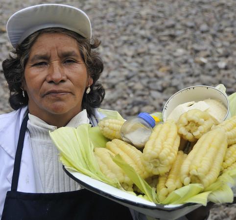 Roasted corn seller outside train window, 2 solis/ear ($0.60), excellent, Ollantaytambo, Urubamba Valley, Peru