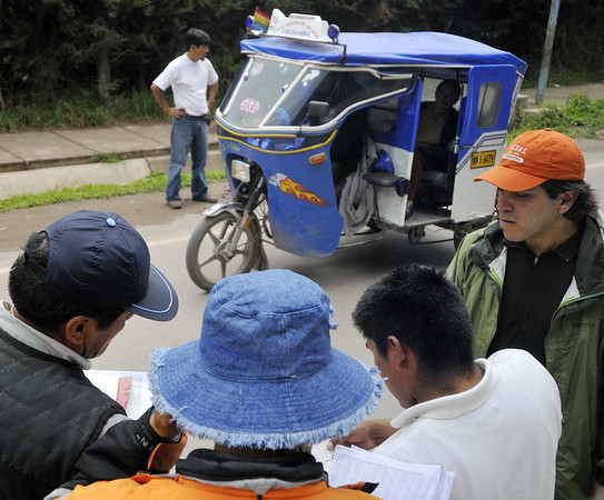 Jorge and our bus driver look on as we are stopped by the police, Urubamba, Peru