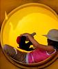 Girl playing in slide opening, Puerto Baquerizo Moreno, San Cristóbal Island