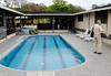 Pool, bar, and dining area