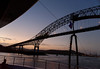 Passing under Bridge of the Americas at dusk