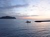 Boat retuning at sunset