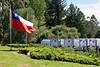 Las Olguitas, Chile - Chiliean flag and salmon tanks