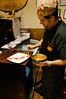 Juan Carlos decorating the plates for dessert