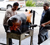 Using a blowtorch, they cook the skin to a crisp, remove it without the fat, scrape off the blackened surface, and serve it as a salty treat