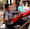 Gentleman operating a hand loom in the artisans' market
