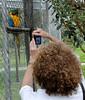 Linda takes the parrot's photo