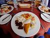 Pork, several corn dishes, corn empanadas, guacamole, and plantain