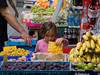 Koblenz, child reading at fruit stand