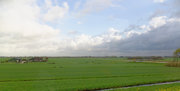 Toward The Hague; the Dutch do love their flat land - the rain is coming