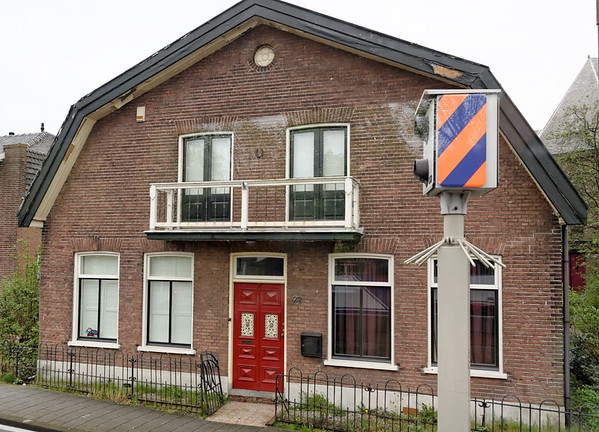 Headed back to Amsterdam; beautifully paneled door on modest Dutch-style house