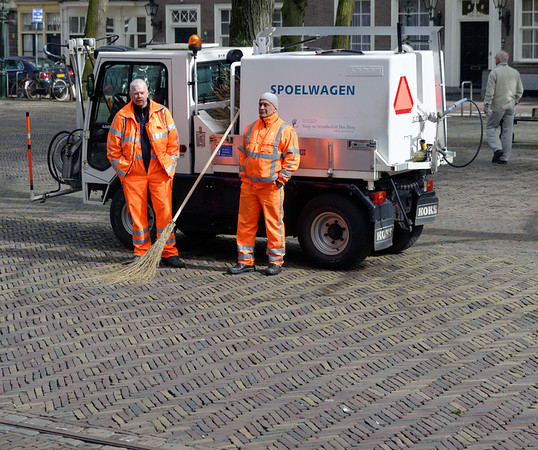 The Hague; modern cleaning truck, old-fashioned broom