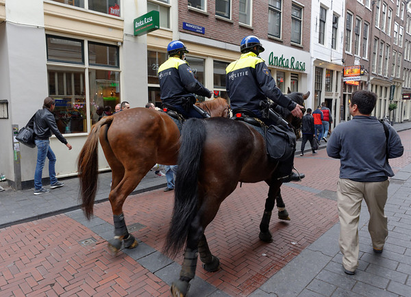 "Amsterdam; red light district, horse patrol, lots of young people, marijuana available at ""coffee"" shops, and lots of great fast food - somehow it all fits together"