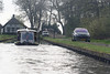 """Giethorn; founded in the 1200s, used to be a carfree town known in the Netherlands as """"Venice of the North"""", has over 150 bridges., The lakes in Giethoorn were formed by peat unearthing.  Little or no car access."""