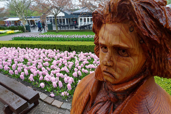 Keukenhof Gardens; statue of Chopin, hycinths, tulips, and cafe in background