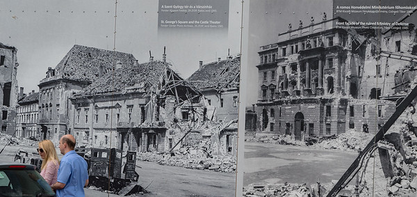 Budapest - walk back to our hotel, posters of WWII destruction
