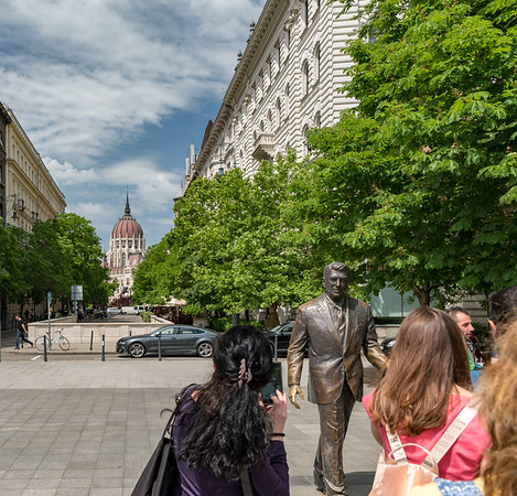 Budapest - Statue of Reagan near the Soviet War Memorial with Parliament in the background