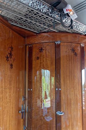 Orient Express - overhead storage and door to sink (one toilet per car)