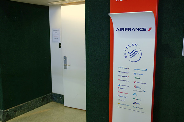 DAY 1:  Air France lounge at IAH, small and packed!