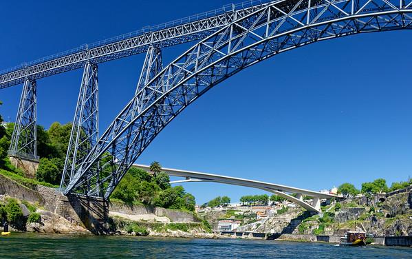 Porto Portugal – Maria Pia Bridge with the Infante D. Henrique Bridge in the background