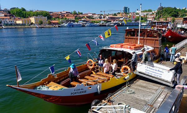 Porto Portugal - boarding the gondola-like tour boat